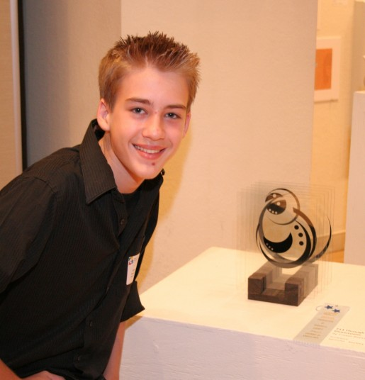 Sarasota High freshman Tristan Rivers with his sculpture, Through Dimensions, winner of the Best of Show award.