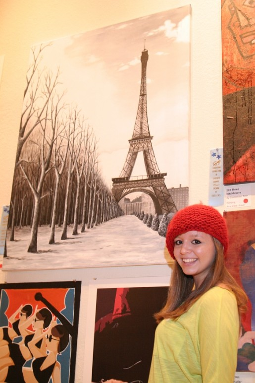 North Port High's Alina TImshina with her painting, B тeckax oтчaяния (In the Depths of Despair).