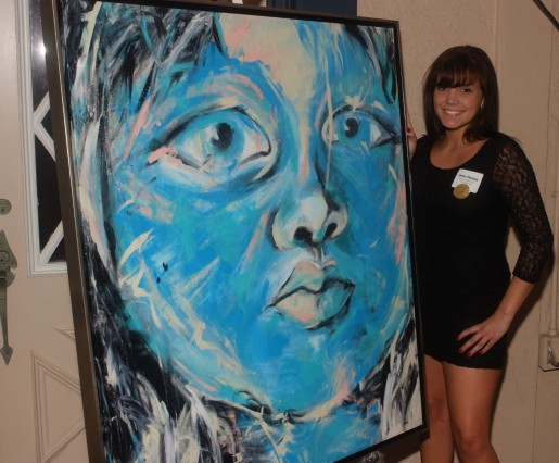 """Venice High School's Holly Mastay with her painting, Blue Child, winner of the 2012 Caldwell Trust Art Award and inspiration for the 2013 Evening of Excellence theme, """"My Blue Heaven."""""""